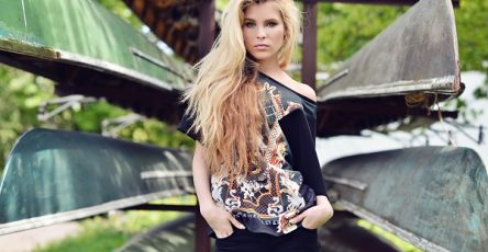 Fashionable portrait of young Ukrainian lady with long hair in the city